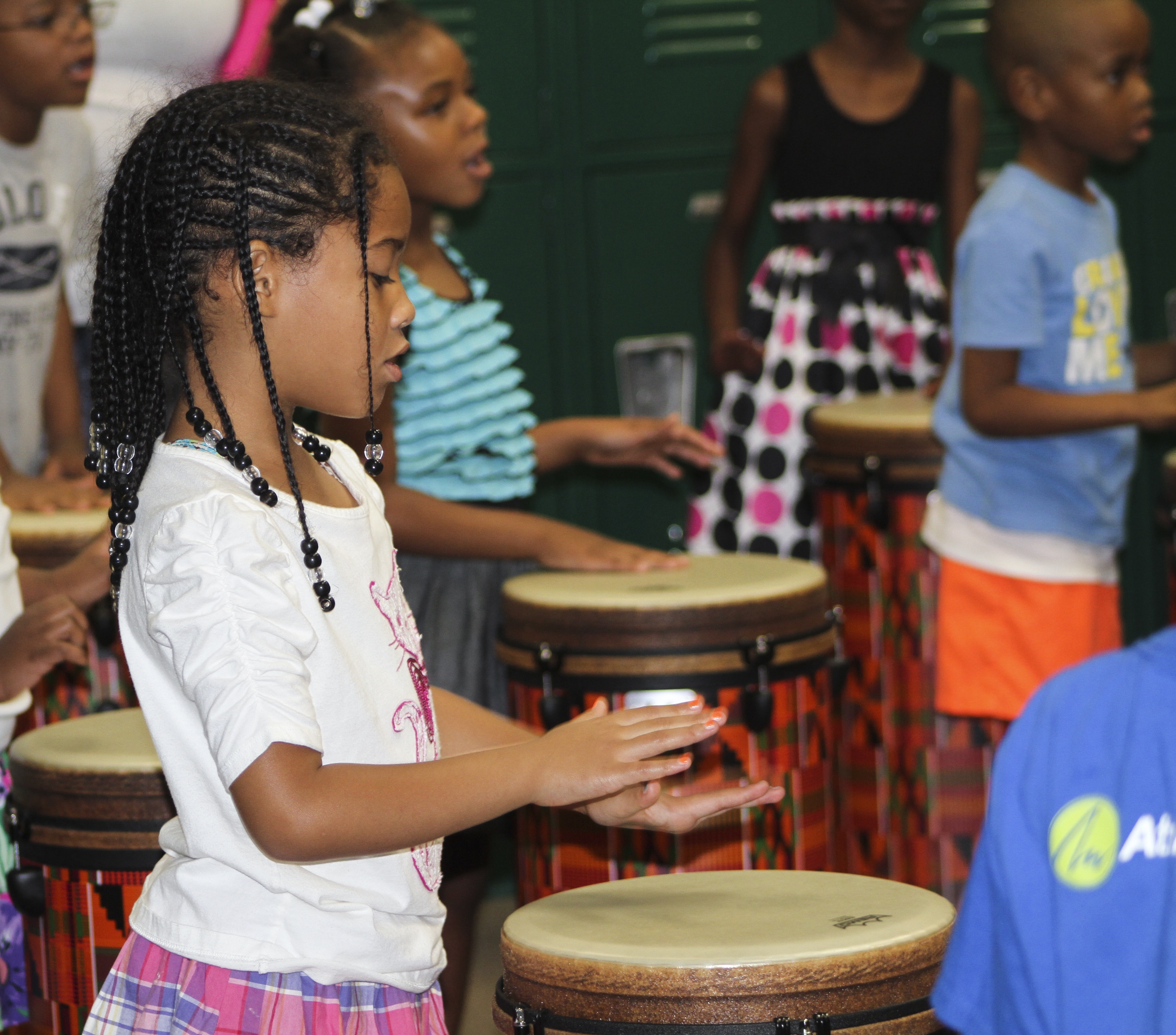 Horizons students playing drums